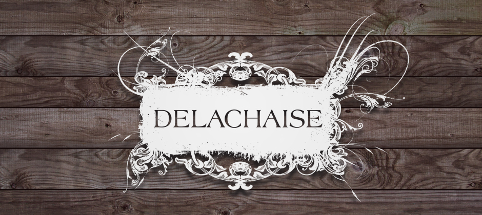 The-delachaise-wine-bar-new-orleans-white-logo-wood-background