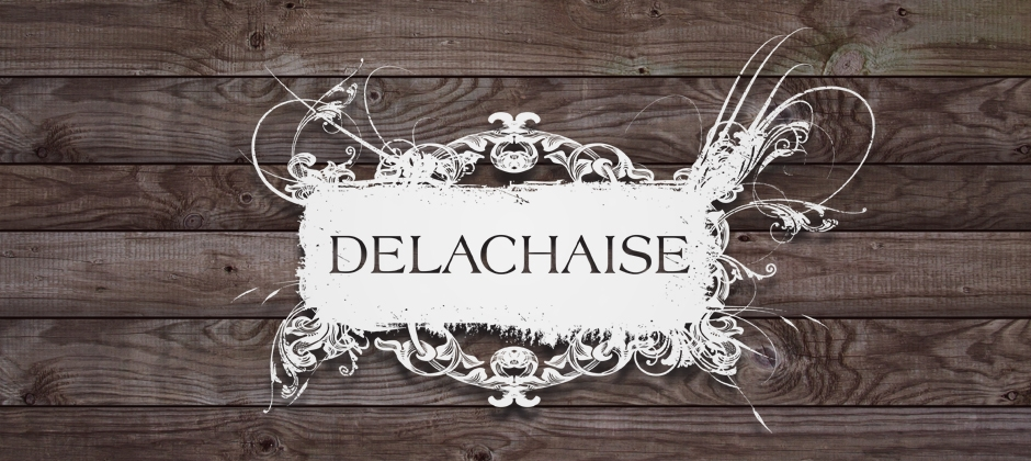 The-delachaise-wine-bar-new-orleans-white-logo-wood-background  large